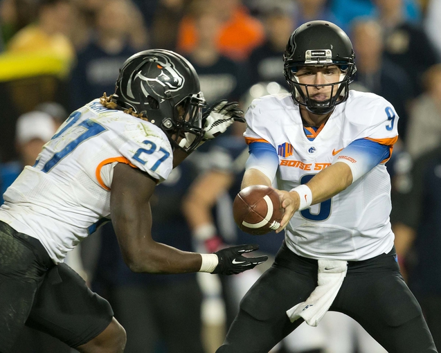 Oct 25, 2013; Provo, UT, USA; Boise State Broncos quarterback Grant Hedrick (9) hands off to running back Jay Ajayi (27) during the second half at Lavell Edwards Stadium. Brigham Young won 37-20. Mandatory Credit: Russ Isabella-USA TODAY Sports