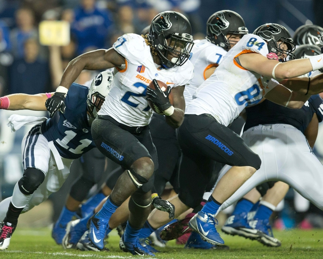 Oct 25, 2013; Provo, UT, USA; Boise State Broncos running back Jay Ajayi (27) runs with the ball as tight end Jake Hardee (84) blocks during the second half against the Brigham Young Cougars at Lavell Edwards Stadium. Brigham Young won 37-20. Mandatory Credit: Russ Isabella-USA TODAY Sports