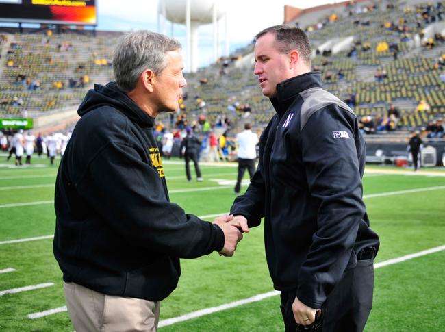 Oct 26, 2013; Iowa City, IA, USA; Iowa Hawkeyes head coach Kirk Ferentz, left, and Northwestern Wildcats head coach Pat Fitzgerald meet prior to the game at Kinnick Stadium. Mandatory Credit: Byron Hetzler-USA TODAY Sports