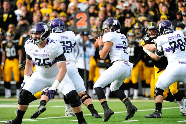 Oct 26, 2013; Iowa City, IA, USA; Northwestern Wildcats quarterback Kain Colter (2) looks to pass in the first quarter against the Iowa Hawkeyes at Kinnick Stadium. Mandatory Credit: Byron Hetzler-USA TODAY Sports