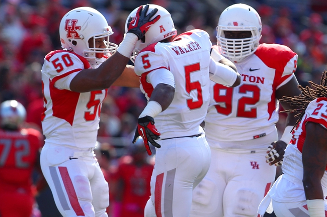 Oct 26, 2013; Piscataway, NJ, USA; Houston Cougars linebacker Efrem Oliphant (50) and Houston Cougars defensive back Turon Walker (5) celebrate Walker's interception during the first half at High Point Solutions Stadium. Mandatory Credit: Ed Mulholland-USA TODAY Sports