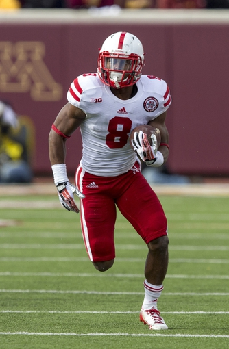Oct 26, 2013; Minneapolis, MN, USA; Nebraska Cornhuskers running back Ameer Abdullah (8) runs with the ball after making a catch in the second quarter against the Minnesota Golden Gophers at TCF Bank Stadium. Mandatory Credit: Jesse Johnson-USA TODAY Sports