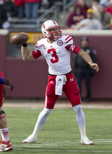 Oct 26, 2013; Minneapolis, MN, USA; Nebraska Cornhuskers quarterback Taylor Martinez (3) attempts a pass in the second quarter against the Minnesota Golden Gophers at TCF Bank Stadium. Mandatory Credit: Jesse Johnson-USA TODAY Sports