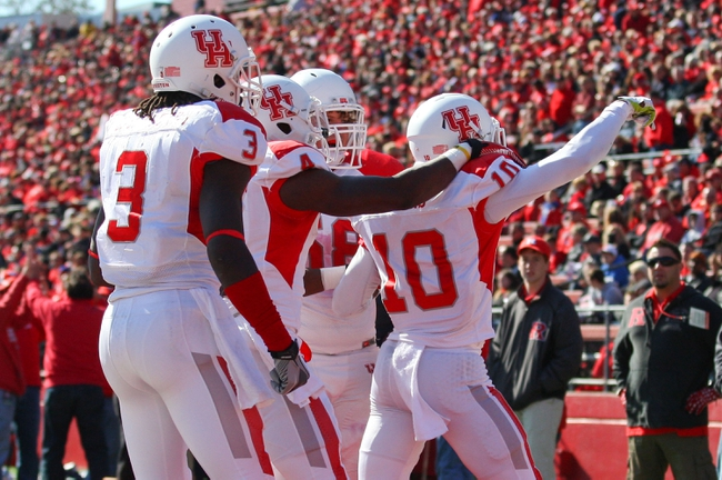 Oct 26, 2013; Piscataway, NJ, USA; Houston Cougars wide receiver Demarcus Ayers (10) celebrates his touchdown catch during the first half at High Point Solutions Stadium. Mandatory Credit: Ed Mulholland-USA TODAY Sports
