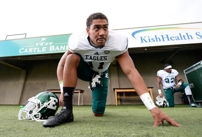 Oct 26, 2013; DeKalb, IL, USA; Eastern Michigan Eagles wide receiver Tyler Allen (11) stretches before the game against the Northern Illinois Huskies at Huskie Stadium. Mandatory Credit: Mike DiNovo-USA TODAY Sports