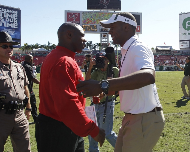 Oct 26, 2013; Tampa, FL, USA; Louisville Cardinals head coach Charlie Strong and South Florida Bulls head coach Wille Taggart greet after the game at Raymond James Stadium. Mandatory Credit: Kim Klement-USA TODAY Sports