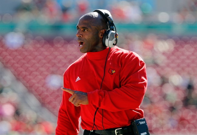 Oct 26, 2013; Tampa, FL, USA; Louisville Cardinals head coach Charlie Strong reacts and points against the South Florida Bulls during the second half at Raymond James Stadium. Mandatory Credit: Kim Klement-USA TODAY Sports