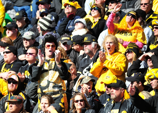 Oct 26, 2013; Iowa City, IA, USA; Iowa Hawkeyes fans cheer during the fourth quarter against the Nothwestern Wildcats at Kinnick Stadium. Mandatory Credit: Byron Hetzler-USA TODAY Sports