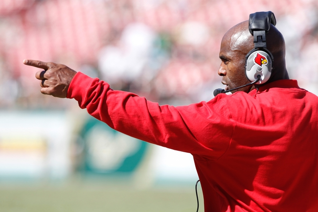 Oct 26, 2013; Tampa, FL, USA; Louisville Cardinals head coach Charlie Strong points against the South Florida Bulls during the second half at Raymond James Stadium. Mandatory Credit: Kim Klement-USA TODAY Sports