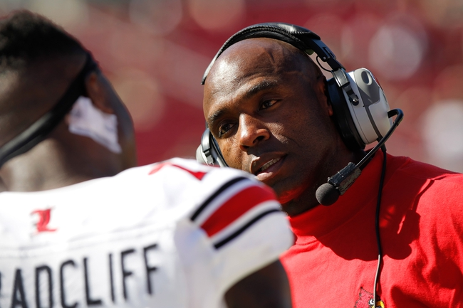 Oct 26, 2013; Tampa, FL, USA; SLouisville Cardinals head coach Charlie Strong talks with running back Brandon Radcliff (23) during the second half against the South Florida Bulls at Raymond James Stadium. Mandatory Credit: Kim Klement-USA TODAY Sports