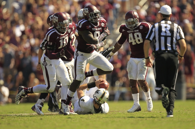 Oct 26, 2013; College Station, TX, USA; Texas A&M Aggies linebacker Steven Jenkins (8) celebrates stopping Vanderbilt Commodores quarterback Patton Robinette (4) during the second half at Kyle Field. Texas A&M won 56-24. Mandatory Credit: Thomas Campbell-USA TODAY Sports