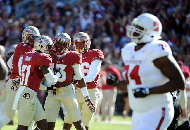 Oct 26, 2013; Tallahassee, FL, USA; Florida State Seminoles defensive back Jalen Ramsey (13) celebrates an interception with defensive back Terrence Brooks (31) during the first quarter of the game against the North Carolina State Wolfpack at Doak Campbell Stadium. Mandatory Credit: Melina Vastola-USA TODAY Sports