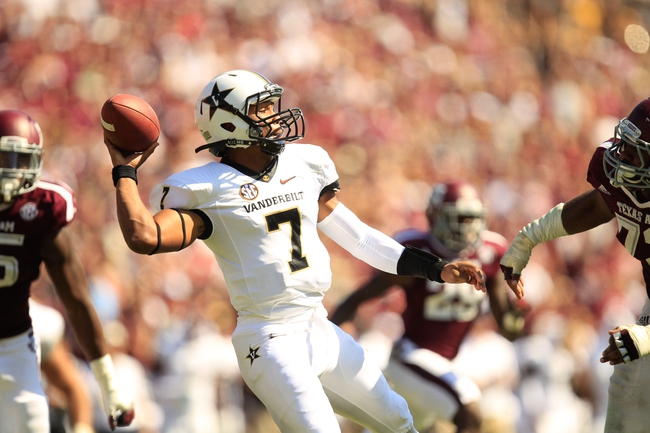 Oct 26, 2013; College Station, TX, USA; Vanderbilt Commodores quarterback Josh Grady (7) passes against the Texas A&M Aggies during the second half at Kyle Field. Texas A&M won 56-24. Mandatory Credit: Thomas Campbell-USA TODAY Sports