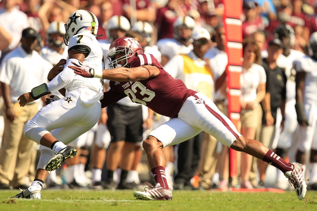 Oct 26, 2013; College Station, TX, USA; Texas A&M Aggies linebacker Shaan Washington (33) sacks Vanderbilt Commodores quarterback Josh Grady (7) during the second half at Kyle Field. Texas A&M won 56-24. Mandatory Credit: Thomas Campbell-USA TODAY Sports