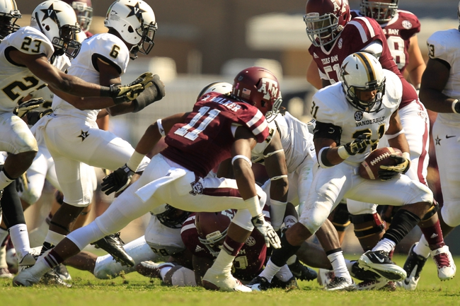 Oct 26, 2013; College Station, TX, USA; Vanderbilt Commodores safety Javon Marshall (31) recovers a fumble against the Texas A&M Aggies during the second half at Kyle Field. Texas A&M won 56-24. Mandatory Credit: Thomas Campbell-USA TODAY Sports