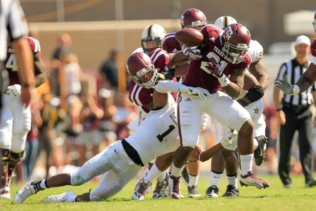 Oct 26, 2013; College Station, TX, USA; Vanderbilt Commodores safety Kenny Ladler (1) forces a fumble from Texas A&M Aggies running back Tra Carson (21) during the second half at Kyle Field. Texas A&M won 56-24. Mandatory Credit: Thomas Campbell-USA TODAY Sports