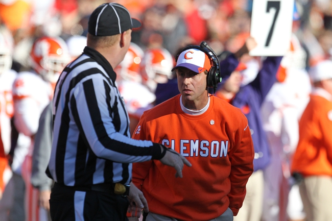 Oct 26, 2013; College Park, MD, USA; Clemson Tigers  head coach Dabo Sweeny questions head linesman Michael Kelley during the game against the Maryland Terrapins at Byrd Stadium. Mandatory Credit: Mitch Stringer-USA TODAY Sports