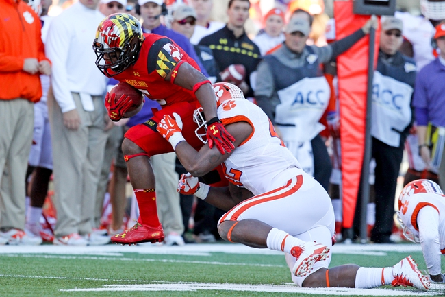 Oct 26, 2013; College Park, MD, USA; Clemson Tigers linebacker Stephone Anthony (42) tackles Maryland Terrapins running back Albert Reid (5) following his run at Byrd Stadium. Mandatory Credit: Mitch Stringer-USA TODAY Sports