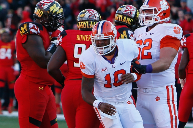 Oct 26, 2013; College Park, MD, USA; Clemson Tigers quarterback Tajh Boyd (10) is helped to his feet after being sacked by guard Tyler Shatley (62) against the Maryland Terrapins at Byrd Stadium. Mandatory Credit: Mitch Stringer-USA TODAY Sports
