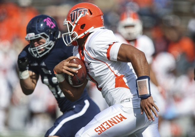 Oct 26, 2013; Houston, TX, USA; UTEP Miners quarterback Jameill Showers (1) runs with the ball during the first quarter against the Rice Owls at Rice Stadium. Mandatory Credit: Troy Taormina-USA TODAY Sports
