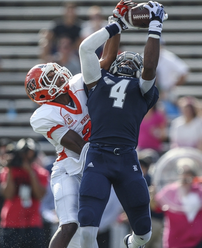 Oct 26, 2013; Houston, TX, USA; Rice Owls wide receiver Dennis Parks (4) catches a pass for a touchdown during the second quarter as UTEP Miners defensive back Ishmael Harrison (2) defends at Rice Stadium. Mandatory Credit: Troy Taormina-USA TODAY Sports