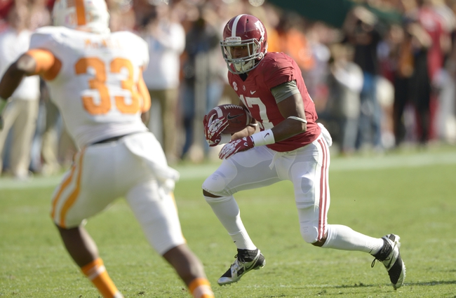 Oct 26, 2013; Tuscaloosa, AL, USA; Alabama Crimson Tide running back Kenyan Drake (17) carries the ball against Tennessee Volunteers defensive back LaDarrell McNeil (33) during the first quarter  at Bryant-Denny Stadium. Mandatory Credit: John David Mercer-USA TODAY Sports