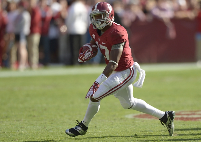 Oct 26, 2013; Tuscaloosa, AL, USA; Alabama Crimson Tide running back Kenyan Drake (17) carries the ball against the Tennessee Volunteers during the first quarter  at Bryant-Denny Stadium. Mandatory Credit: John David Mercer-USA TODAY Sports