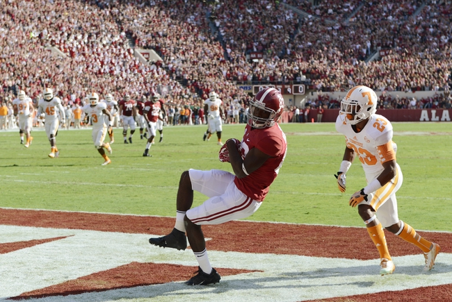 Oct 26, 2013; Tuscaloosa, AL, USA; Alabama Crimson Tide wide receiver Kevin Norwood (83) hauls in a touchdown pass past Tennessee Volunteers defensive back Cameron Sutton (23) during the first quarter at Bryant-Denny Stadium. Mandatory Credit: John David Mercer-USA TODAY Sports