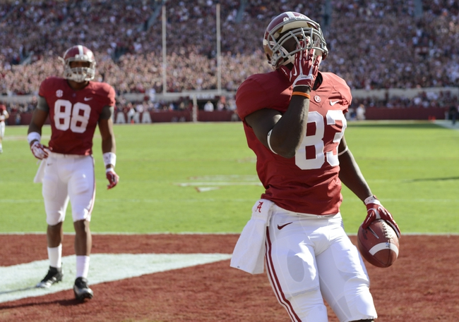 Oct 26, 2013; Tuscaloosa, AL, USA; Alabama Crimson Tide wide receiver Kevin Norwood (83) celebrates his touchdown in the end zone against the Tennessee Volunteers during the first quarter at Bryant-Denny Stadium. Mandatory Credit: John David Mercer-USA TODAY Sports