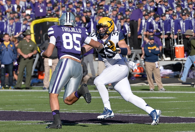 Oct 26, 2013; Manhattan, KS, USA; West Virginia Mountaineers linebacker Nick Kwiatkoski (35) pressures Kansas State Wildcats tight end Zach Trujillo (85) for position during the first half at Bill Snyder Family Stadium. Mandatory Credit: Jasen Vinlove-USA TODAY Sports