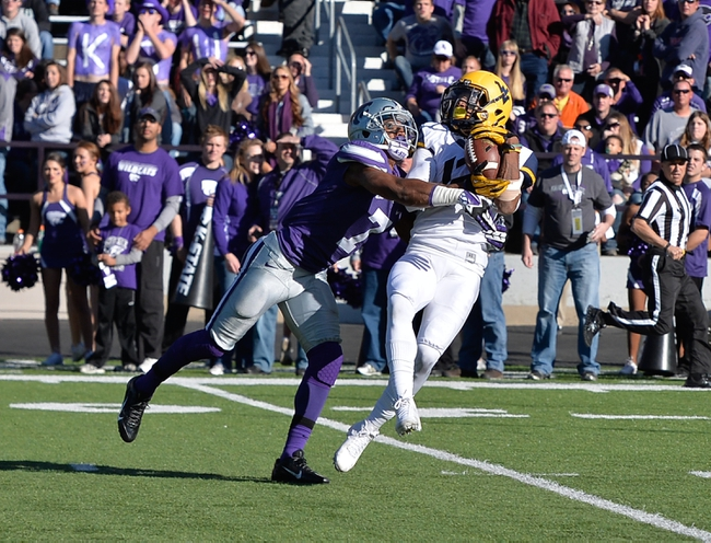 Oct 26, 2013; Manhattan, KS, USA; West Virginia Mountaineers wide receiver Ronald Carswell (12) makes a catch while being defended by Kansas State Wildcats defensive back Kip Daily (7) during the first half at Bill Snyder Family Stadium. Mandatory Credit: Jasen Vinlove-USA TODAY Sports