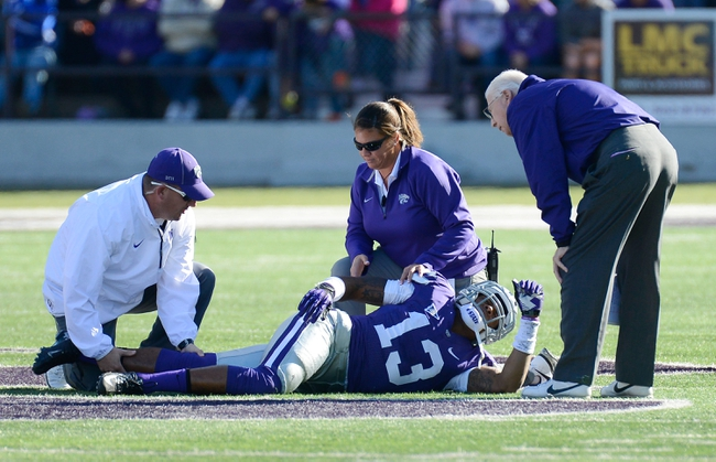 Oct 26, 2013; Manhattan, KS, USA; Kansas State Wildcats defensive back Travis Green (13) is injured on a play against the West Virginia Mountaineers during the first half at Bill Snyder Family Stadium. Mandatory Credit: Jasen Vinlove-USA TODAY Sports