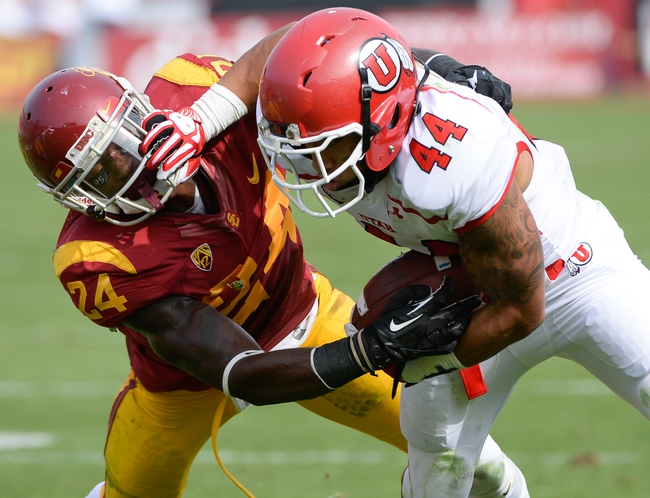 Oct 26, 2013; Los Angeles, CA, USA;  Utah Utes running back Lucky Radley (44) stiff arms USC Trojans safety Demetrius Wright (24) to try to avoid being tackled during second quarter action at Los Angeles Memorial Coliseum. Mandatory Credit: Robert Hanashiro-USA TODAY Sports