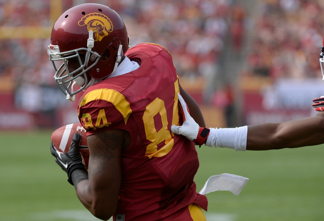 Oct 26, 2013; Los Angeles, CA, USA;  USC Trojans wide receiver Darreus Rogers (84) gets push out of bounds  during second quarter action against the Utah Utes at Los Angeles Memorial Coliseum. Mandatory Credit: Robert Hanashiro-USA TODAY Sports