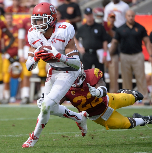 Oct 26, 2013; Los Angeles, CA, USA;  Utah Utes wide receiver Dres Anderson (6) tries to run past a flying tackle by USC Trojans safety Leon McQuay III (22) during second quarter action at Los Angeles Memorial Coliseum. Mandatory Credit: Robert Hanashiro-USA TODAY Sports