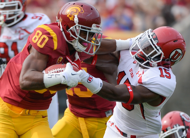 Oct 26, 2013; Los Angeles, CA, USA;  USC Trojans wide receiver De'Von Flournoy (80) stiff arms Utah Utes defensive back Michael Walker (15) to gain some extra yards during second quarter action at Los Angeles Memorial Coliseum. Mandatory Credit: Robert Hanashiro-USA TODAY Sports