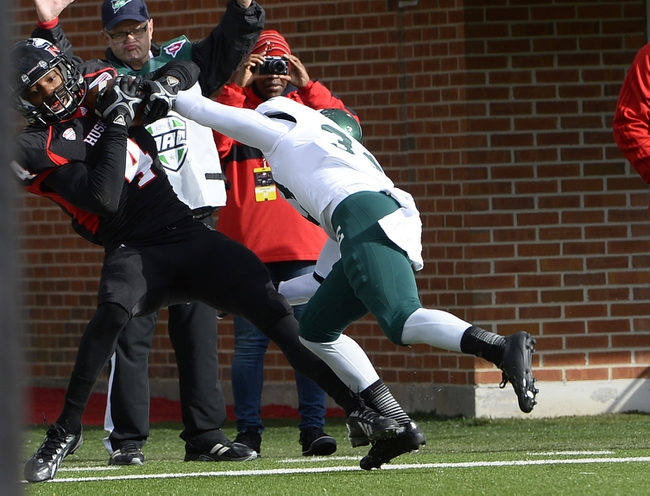 Oct 26, 2013; DeKalb, IL, USA; Northern Illinois Huskies wide receiver Da'Ron Brown (4) makes a touchdown catch against Eastern Michigan Eagles defensive back Quan Pace (33) during the first half at Huskie Stadium. Mandatory Credit: Mike DiNovo-USA TODAY Sports