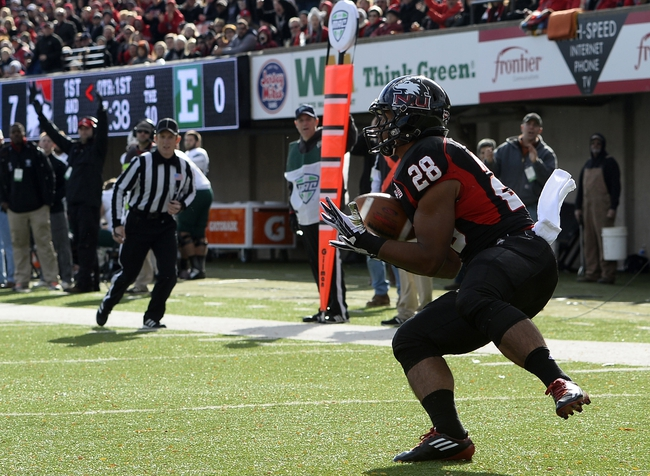 Oct 26, 2013; DeKalb, IL, USA; Northern Illinois Huskies running back Joel Bouagnon (28) makes a touchdown catch against the Eastern Michigan Eagles during the first half at Huskie Stadium. Mandatory Credit: Mike DiNovo-USA TODAY Sports