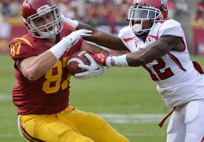 Oct 26, 2013; Los Angeles, CA, USA;  USC Trojans tight end Chris Willson (87) makes a catch near the sideline in front of  Utah Utes defensive back Justin Thomas (12) during second quarter action at Los Angeles Memorial Coliseum. Mandatory Credit: Robert Hanashiro-USA TODAY Sports