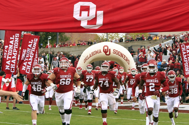 Oct 26, 2013; Norman, OK, USA; The Oklahoma Sooners run onto the field before the start of a game against the Texas Tech Red Raiders at Gaylord Family-Oklahoma Memorial Stadium. Mandatory Credit: Alonzo Adams-USA TODAY Sports