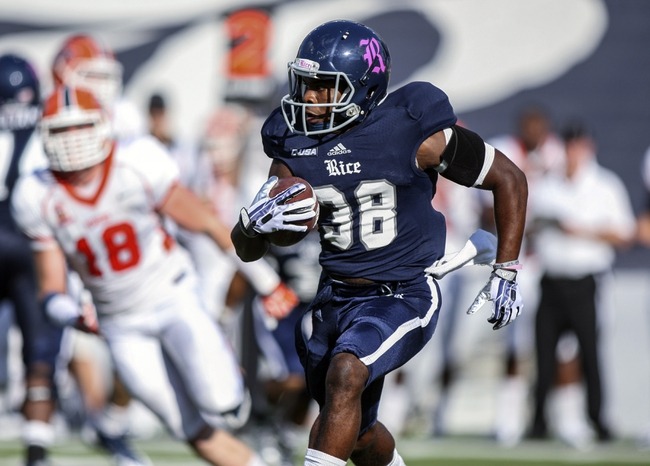 Oct 26, 2013; Houston, TX, USA; Rice Owls cornerback Darrion Pollard (38) runs with the ball during the third quarter against the UTEP Miners at Rice Stadium. Mandatory Credit: Troy Taormina-USA TODAY Sports