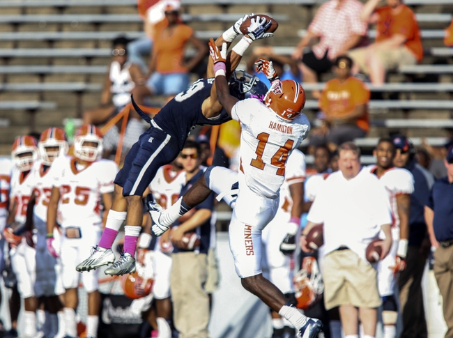 Oct 26, 2013; Houston, TX, USA; Rice Owls cornerback Bryce Callahan (29) intercepts a pass away from UTEP Miners wide receiver Ian Hamilton (14) during the third quarter at Rice Stadium. Mandatory Credit: Troy Taormina-USA TODAY Sports