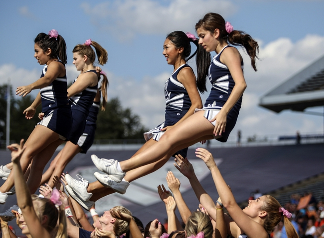 Oct 26, 2013; Houston, TX, USA; Rice Owls cheerleaders perform during a game against the UTEP Miners at Rice Stadium. Mandatory Credit: Troy Taormina-USA TODAY Sports