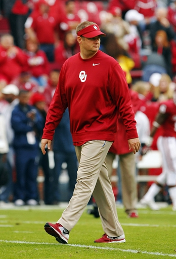 Oct 26, 2013; Norman, OK, USA; Oklahoma coach Josh Huepel before the start of a game against the Texas Tech Red Raiders at Gaylord Family - Oklahoma Memorial Stadium. Mandatory Credit: Alonzo Adams-USA TODAY Sports