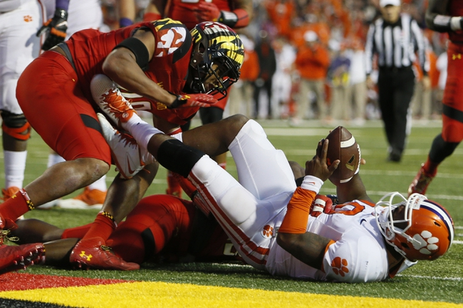 Oct 26, 2013; College Park, MD, USA; Clemson Tigers quarterback Tajh Boyd (10) runs for a second half touchdown against the Maryland Terrapins at Byrd Stadium. Mandatory Credit: Mitch Stringer-USA TODAY Sports