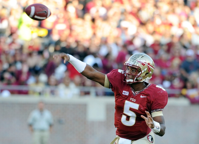 Oct 26, 2013; Tallahassee, FL, USA; Florida State Seminoles quarterback Jameis Winston (5) throws the ball during the game against the North Carolina State Wolfpack at Doak Campbell Stadium. Mandatory Credit: Melina Vastola-USA TODAY Sports
