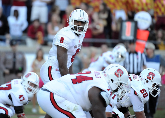 Oct 26, 2013; Tallahassee, FL, USA; North Carolina State Wolfpack quarterback Brandon Mitchell (8) prepares to start the play during the second half of the game against the Florida State Seminoles at Doak Campbell Stadium. Mandatory Credit: Melina Vastola-USA TODAY Sports