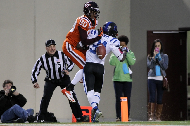Oct 26, 2013; Blacksburg, VA, USA; Virginia Tech Hokies wide receiver Demitri Knowles (80) tries to catch a pass over Duke Blue Devils cornerback Breon Borders (31) during the fourth quarter at Lane Stadium. Mandatory Credit: Peter Casey-USA TODAY Sports