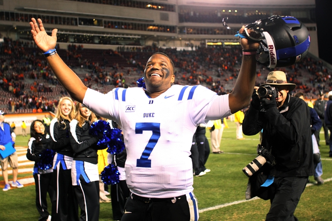 Oct 26, 2013; Blacksburg, VA, USA; Duke Blue Devils quarterback Anthony Boone (7) celebrates after the game against the Virginia Tech Hokies at Lane Stadium. Mandatory Credit: Peter Casey-USA TODAY Sports