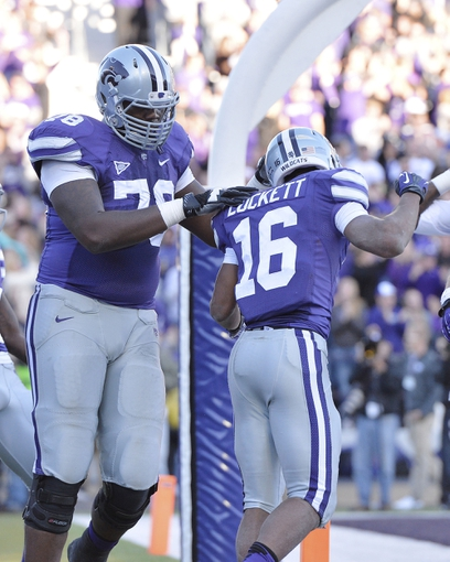 Oct 26, 2013; Manhattan, KS, USA; Kansas State Wildcats wide receiver Tyler Lockett (16) is congratulated by offensive linesman Cornelius Lucas (78) after scoring a touchdown against the West Virginia Mountaineers during the second half at Bill Snyder Family Stadium. The Wildcats defeat the Mountaineers 35-12. Mandatory Credit: Jasen Vinlove-USA TODAY Sports